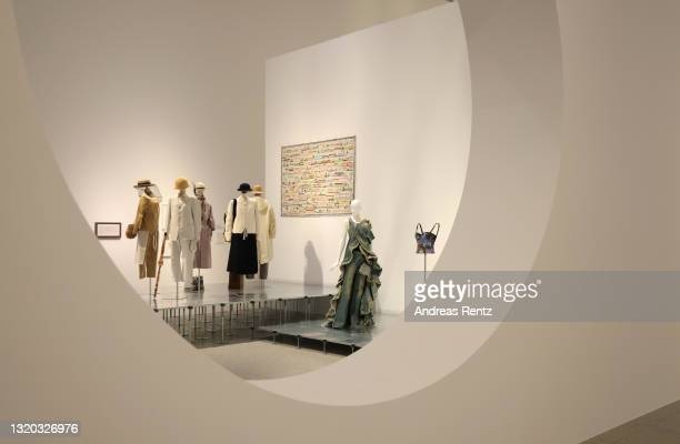 Denim dress and jeans by Junya Watanabe of Comme des Garcon and various dresses are seen during the exhibition Dress Code: Are You Playing Fashion? -...