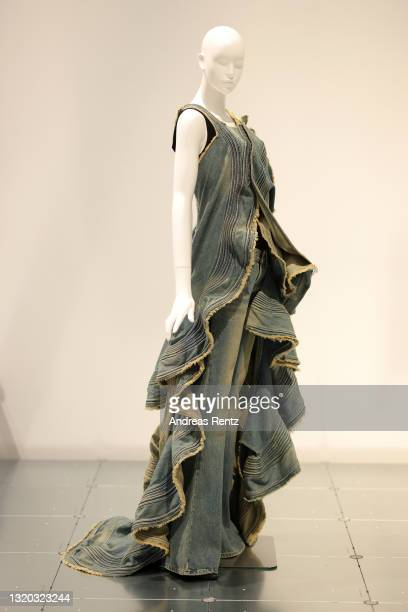 Denim dress and jeans by Junya Watanabe of Comme des Garcon is seen during the exhibition Dress Code: Are You Playing Fashion? - A collection of The...