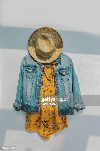 denim jacket and floral summer yellow dress with sunhat - multi colored dress stock pictures, royalty-free photos & images