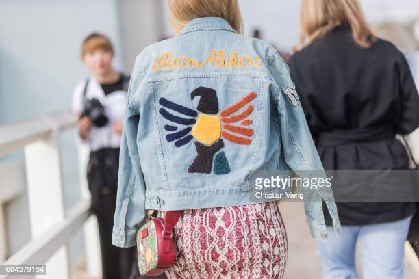 A denim jacket with the print rain maker outside Ten Pieces at day 5 during MercedesBenz Fashion Week Resort 18 Collections at Icebergs on May 18...