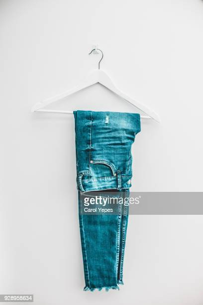 denim jeans on hanger - trousers stock pictures, royalty-free photos & images