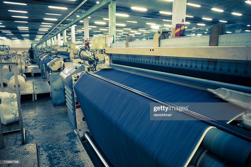 denim textile industry making jeans fabric airjet looms stock photo