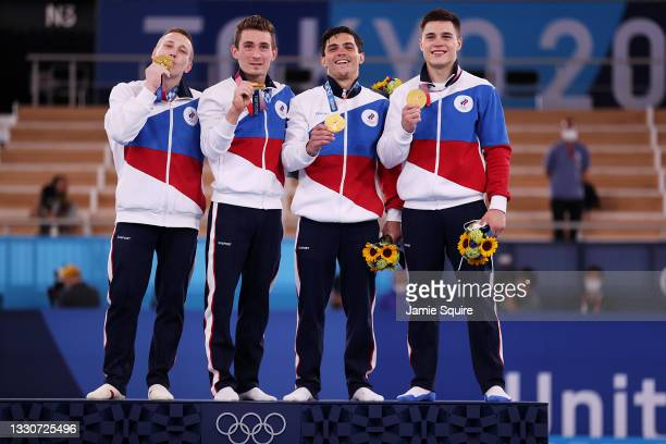 Denis Abliazin, David Belyavskiy, Artur Dalaloyan and Nikita Nagornyy of Team ROC pose with the gold medal on the podium during the medal ceremony...