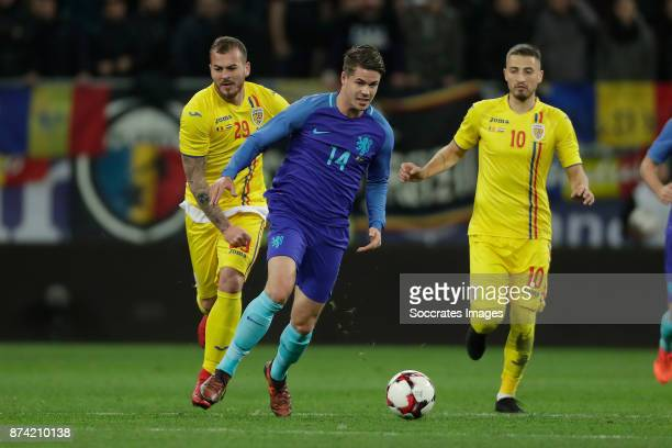 Denis Alibec of Romania Marco van Ginkel of Holland during the International Friendly match between Romania v Holland at the Arena Nationala on...