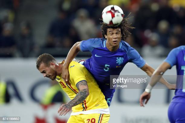 Denis Alibec of Romania Nathan Ake of Holland during the friendly match between Romania and The Netherlands on November 14 2017 at Arena National in...