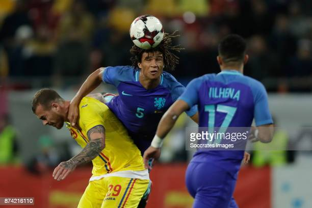 Denis Alibec of Romania Nathan Ake of Holland during the International Friendly match between Romania v Holland at the Arena Nationala on November 14...