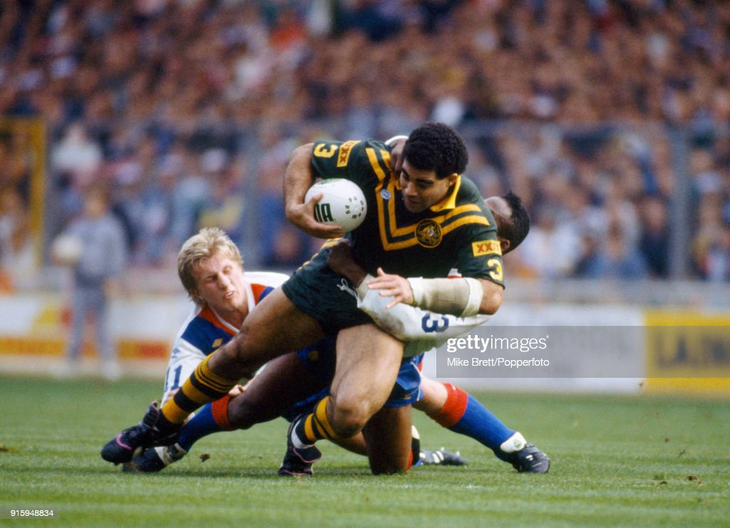 Denis Betts (left) and Ellery Hanley of Great Britain rugby league tackle Mal Meninga of Austalia during their International match at Wembley Stadium in London on 27th October 1990. Great Britain won 19-12.