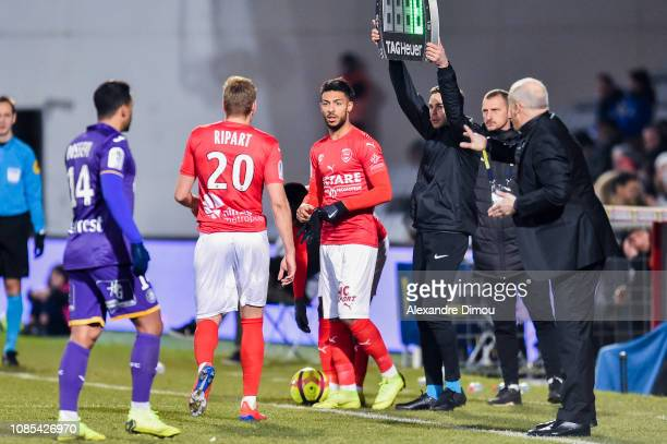 Denis Bouanga and Renaud Ripart of Nimes during the Ligue 1 match between Nimes and Toulouse at Stade des Costieres on January 19 2019 in Nimes France