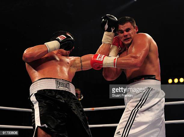 Denis Boytsov of Russia exchanges punches with Jason Gavern of USA during a heavyweight fight during the Universum Champions night boxing at the...