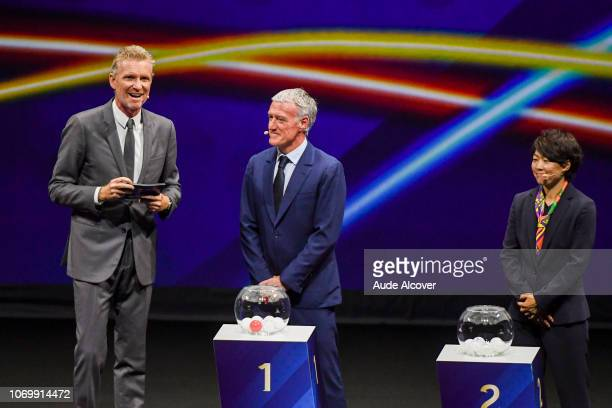 Denis Brogniart head coach of France Didier Deschamps and Aya Miyama of Japan during the Women's World Cup Draw 2019 at La Seine Musicale on December...