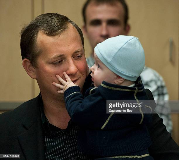 Denis Bukhantsov, the husband of Alina Bukhantsov who was brutally killed in their home along with their children, Emmanuela and Avenir holds his...
