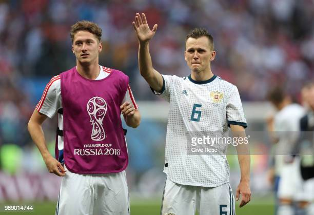 Denis Cheryshev and Alexey Miranchuk of Russia celebrate victory following the 2018 FIFA World Cup Russia Round of 16 match between Spain and Russia...