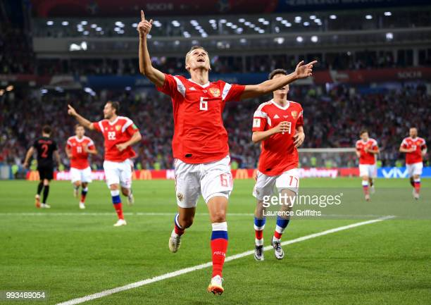 Denis Cheryshev of Russia celebrates after scoring his team's first goal during the 2018 FIFA World Cup Russia Quarter Final match between Russia and...