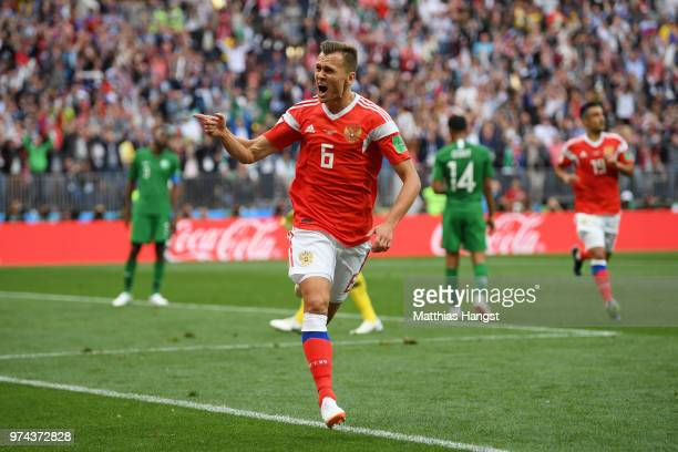 Denis Cheryshev of Russia celebrates after scoring his team's second goal during the 2018 FIFA World Cup Russia Group A match between Russia and...