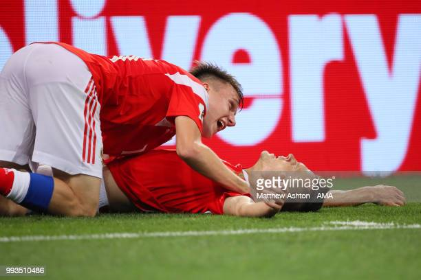 Denis Cheryshev of Russia celebrates scoring a goal to make it 10 with Roman Zobnin of Russia during the 2018 FIFA World Cup Russia Quarter Final...