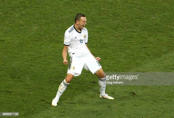 Denis Cheryshev of Russia celebrates scoring his team's fourth penalty in the penalty shoot out during the 2018 FIFA World Cup Russia Round of 16...
