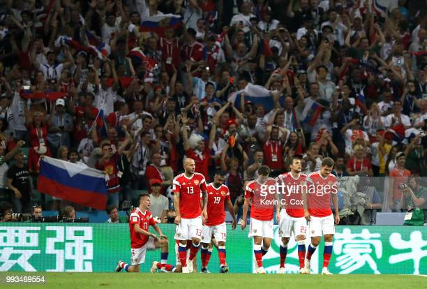 Denis Cheryshev of Russia celebrates with team mates after scoring his team's first goal during the 2018 FIFA World Cup Russia Quarter Final match...