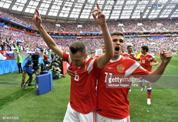 Denis Cheryshev of Russia celebrates with teammate Roman Zobnin after scoring his team's second goal during the 2018 FIFA World Cup Russia Group A...