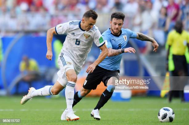 Denis Cheryshev of Russia competes with Nahitan Nandez of Uruguay during the 2018 FIFA World Cup Russia group A match between Uruguay and Russia at...