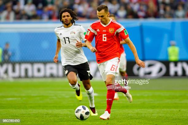 Denis Cheryshev of Russia drives the ball against Mohamed Elneny of Egypt during the 2018 FIFA World Cup Russia group A match between Russia and...