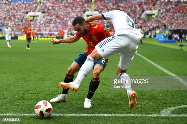 Denis Cheryshev of Russia is tackled by Dani Carvajal of Spain during the 2018 FIFA World Cup Russia Round of 16 match between Spain and Russia at...