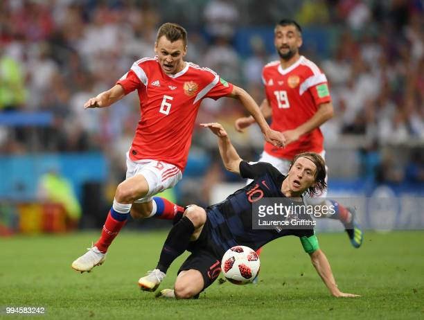 Denis Cheryshev of Russia is tackled by Luka Modric of Craotia during the 2018 FIFA World Cup Russia Quarter Final match between Russia and Croatia...