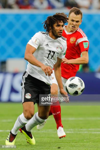 Denis Cheryshev of Russia national team and Mohamed Elneny of Egypt national team vie for the ball during the 2018 FIFA World Cup Russia group A...