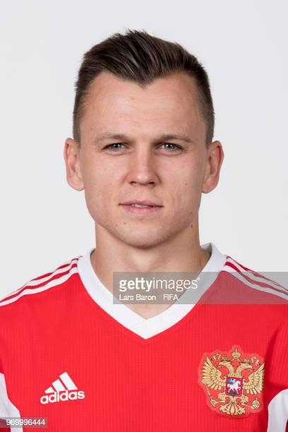 Denis Cheryshev of Russia poses for a portrait during the official FIFA World Cup 2018 portrait session at Federal Sports Centre Novogorsk on June 8...
