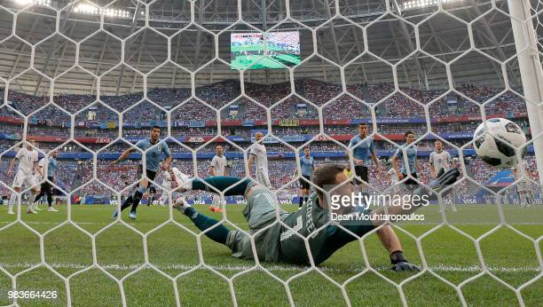 Denis Cheryshev of Russia scores an own goal deflecting Diego Laxalt of Uruguay's shot to put Uruguay infront 20 during the 2018 FIFA World Cup...