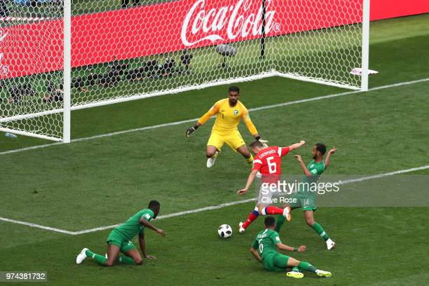 Denis Cheryshev of Russia scores his sides second goal pass Abdullah Almuaiouf of Saudi Arabia during the 2018 FIFA World Cup Russia Group A match...