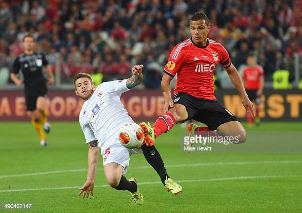Denis Cheryshev of Sevilla and Guilherme Siqueira of Benfica compete for the ball during the UEFA Europa League Final match between Sevilla FC and SL...