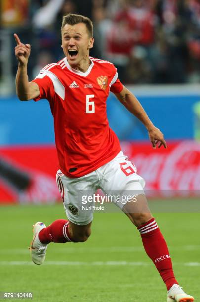 Denis Cheryshev of the Russia national football team celebrates after scoring a goal during the 2018 FIFA World Cup match first stage Group A between...