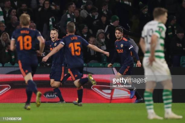 Denis Cheryshev of Valencia celebrates after he scores his sides first goal during the UEFA Europa League Round of 32 First Leg match between Celtic...