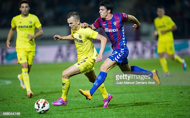 Denis Cheryshev of Villarreal CF duels for the ball with Ander Capa of SD Eibar during the La Liga match between SD Eibar and Villarreal CF at Ipurua...