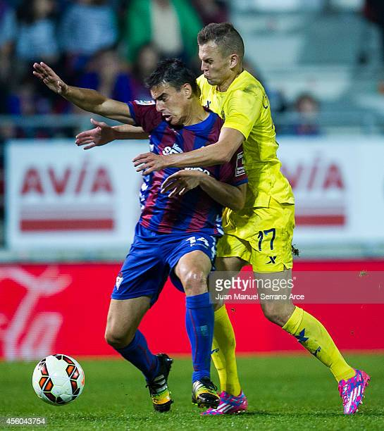 Denis Cheryshev of Villarreal CF duels for the ball with Daniel Garcia of SD Eibar during the La Liga match between SD Eibar and Villarreal CF at...