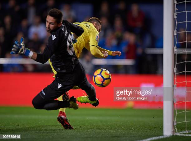 Denis Cheryshev of Villarreal competes for the ball with Oier Olazabal of Levante during the La Liga match between Villarreal and Levante at Estadio...