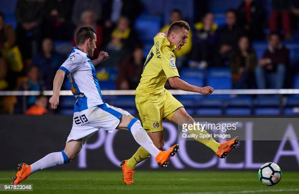 Denis Cheryshev of Villarreal competes for the ball with Roberto Roman Triguero of Leganes during the La Liga match between Villarreal and Leganes at...