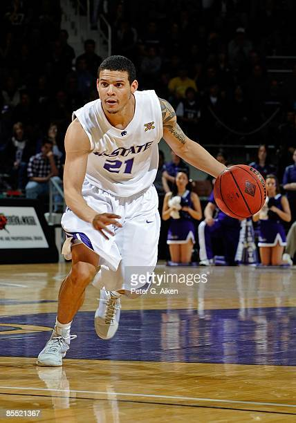 Denis Clemente of the Kansas State Wildcats brings the ball up court against the Illinois State Redbirds during the first round of the NIT on March...