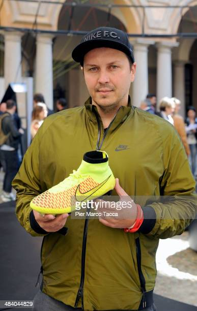 Denis Dekovic Global Football Designer Director of Nike poses with the Magista boot during the unveilling of Magista boots at the Nike installation...
