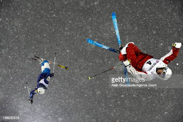 Denis Dolgodorov of Russia and Mikael Kingsbury of Canada compete during the FIS Freestyle Ski World Cup Dual Moguls on December 20 2011 in Meribel...