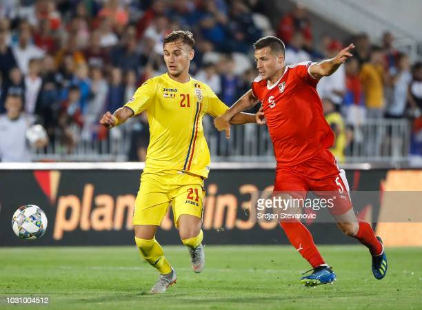 Denis Dragus of Romania in action against Uros Spajic of Serbia during the UEFA Nations League C group four match between Serbia and Romania at...