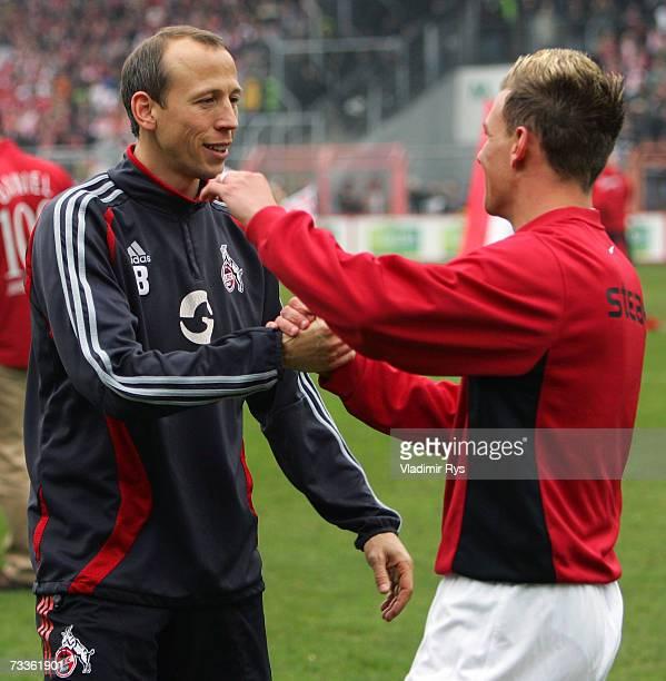 Denis Epstein of Essen gives a hug to his former team mate Matthias Scherz of Cologne prior to the Second Bundesliga match between Rot Weiss Essen...