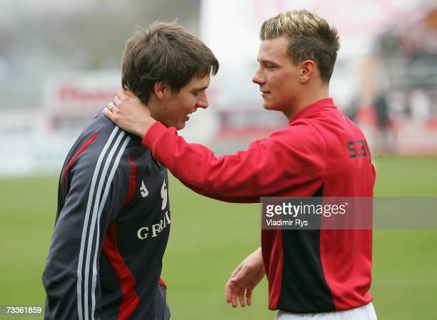 Denis Epstein of Essen gives a hug to his former team mate Patrick Helmes of Cologne prior to the Second Bundesliga match between Rot Weiss Essen and...