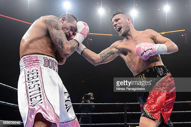 Denis Farias punches Sebastien Bouchard during the super welterweight bout at Pepsi Coliseum on April 4 2015 in Quebec City Quebec Canada