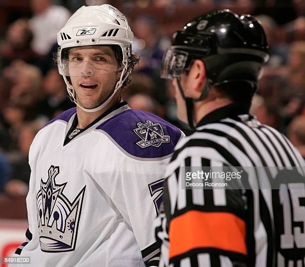 Denis Gauthier of the Los Angeles Kings talks to the Referee Stephane Auger during the game against the Anaheim Ducks on February 18 2009 at Honda...