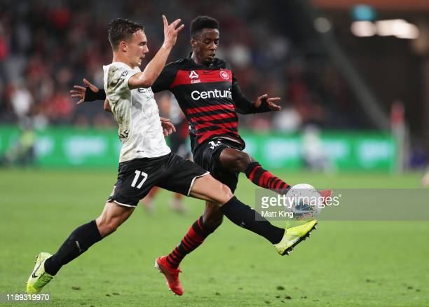 Denis Genreau of Melbourne City FC competes for the ball against Bruce Kamau of the Wanderers during the round 7 A-League match between the Western...