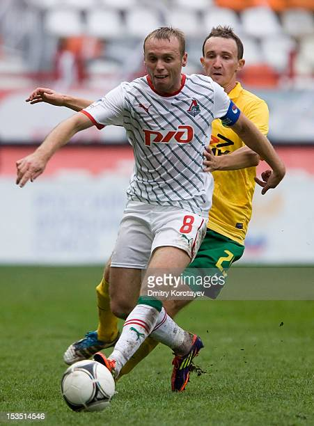 Denis Glushakov of FC Lokomotiv Moscow battles for the ball with Aleksei Kozlov of FC Kuban Krasnodar during the Russian Premier League match between...
