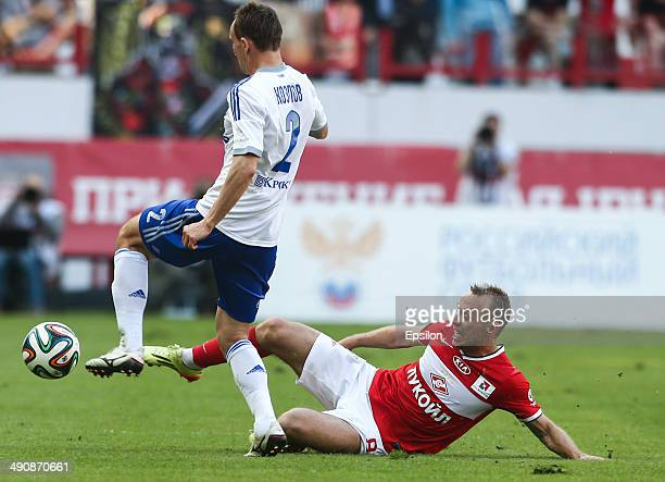 Denis Glushakov of FC Spartak Moscow is challenged by Aleksei Kozlov of FC Dynamo Moscow during the Russian Premier League match between FC Spartak...