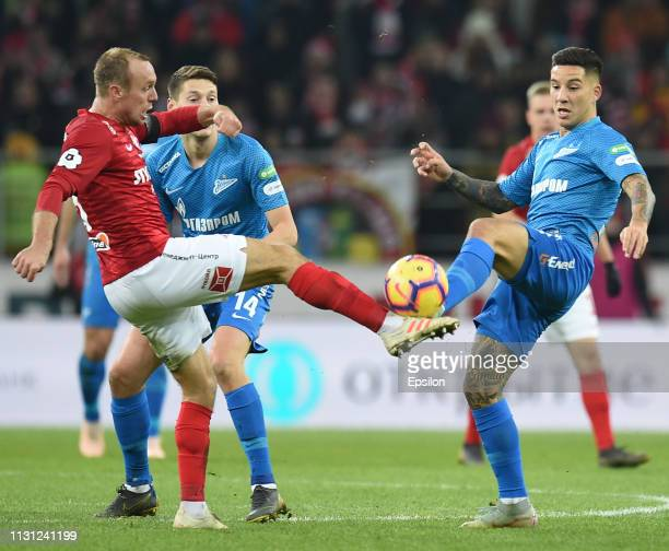 Denis Glushakov of FC Spartak Moscow vies for the ball with Sebastian Driussi of FC Zenit Saint Petersburg during the Russian Premier League match...