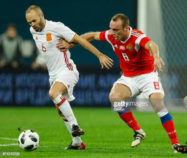Denis Glushakov of Russia and Andres Iniesta of Spain vie for the ball during Russia and Spain International friendly match on November 14 2017 at...